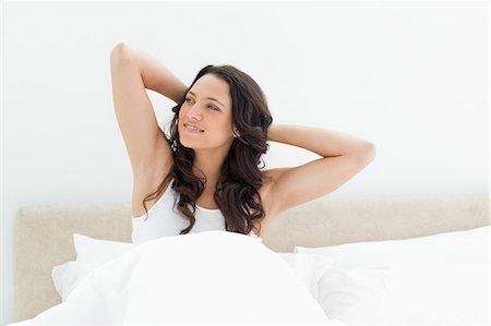 Cute brunette waking up Stock Photo - Premium Royalty-Free, Code: 6109-06194214