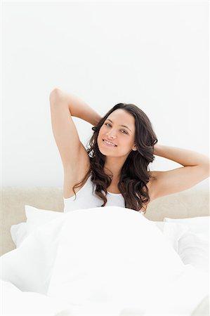 Smiling brunette waking up Stock Photo - Premium Royalty-Free, Code: 6109-06194216