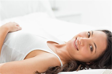 Delighted woman smiling in her bed Stock Photo - Premium Royalty-Free, Code: 6109-06194227