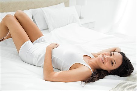 sexy - Pleasing woman lying in her bed Stock Photo - Premium Royalty-Free, Code: 6109-06194229