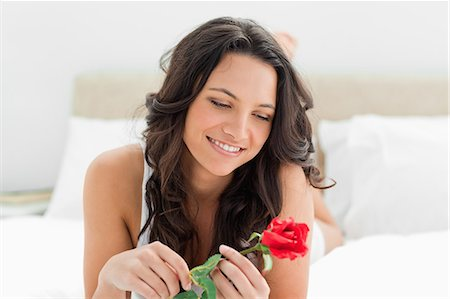 Beautiful young woman holding a rose Stock Photo - Premium Royalty-Free, Code: 6109-06194389