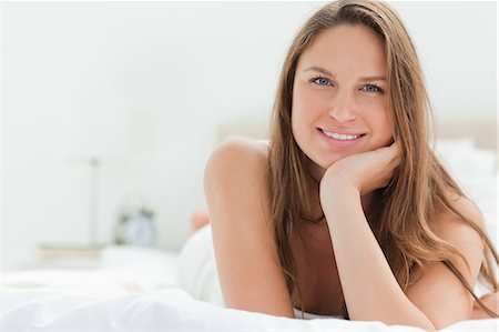 Caucasian woman lying on her bed Stock Photo - Premium Royalty-Free, Code: 6109-06194452