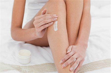Woman applying moisturizer Stock Photo - Premium Royalty-Free, Code: 6109-06194520