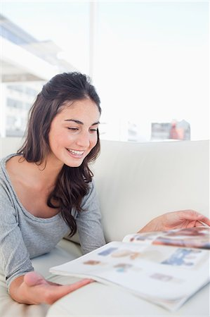 Beaming student reading a magazine Stock Photo - Premium Royalty-Free, Code: 6109-06194796