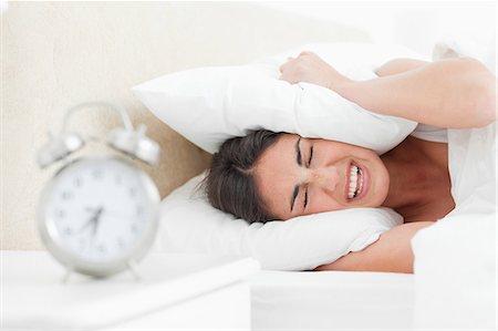 Rude awakening for a brunette Stock Photo - Premium Royalty-Free, Code: 6109-06194896