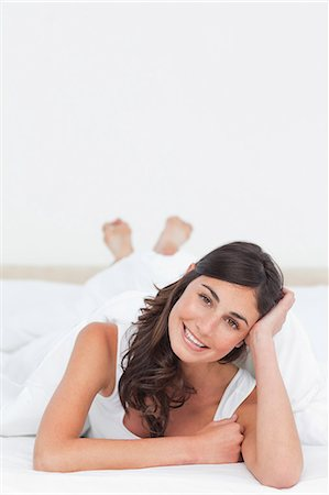 Portrait of a woman lying on the belly Stock Photo - Premium Royalty-Free, Code: 6109-06194917