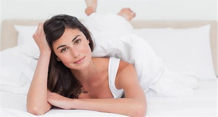 Portrait of a brunette lying on the belly Stock Photo - Premium Royalty-Free, Code: 6109-06194915