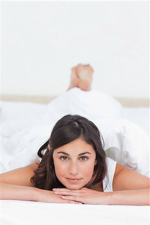 Portrait of a student lying on her belly Stock Photo - Premium Royalty-Free, Code: 6109-06194919