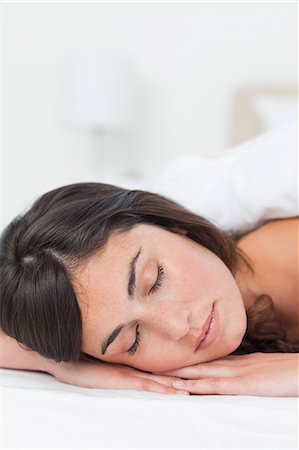 Close-up of a brunette having a nap Stock Photo - Premium Royalty-Free, Code: 6109-06194924