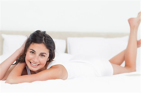 Portrait of a beautiful woman in her bed Stock Photo - Premium Royalty-Free, Code: 6109-06194935
