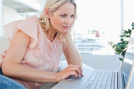 Blonde on a laptop Stock Photo - Premium Royalty-Free, Code: 6109-06195048