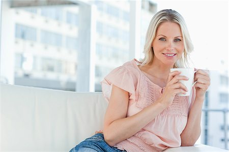 Portrait of a blonde with a cappuccino Stock Photo - Premium Royalty-Free, Code: 6109-06195068