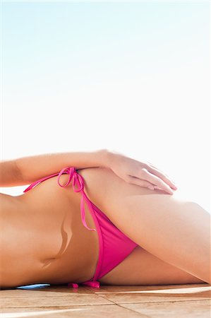 Female lower body on the swimming pool edge Stock Photo - Premium Royalty-Free, Code: 6109-06195117