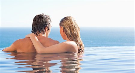 swimming pool water - Back view of couple spending time in the pool Stock Photo - Premium Royalty-Free, Code: 6109-06195123