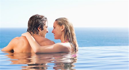 passion - Back view of couple in the pool Stock Photo - Premium Royalty-Free, Code: 6109-06195124