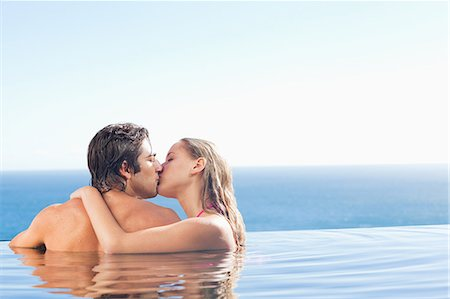 Back view of kissing couple in the pool Stock Photo - Premium Royalty-Free, Code: 6109-06195125