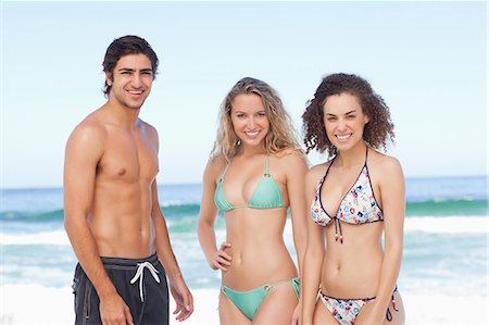 sexy black women in bikinis - Three friends looking ahead while standing by the sea Stock Photo - Premium Royalty-Free, Code: 6109-06195469