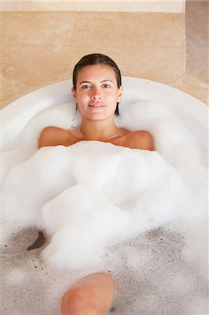 Woman relaxing in the tub Stock Photo - Premium Royalty-Free, Code: 6109-06195745