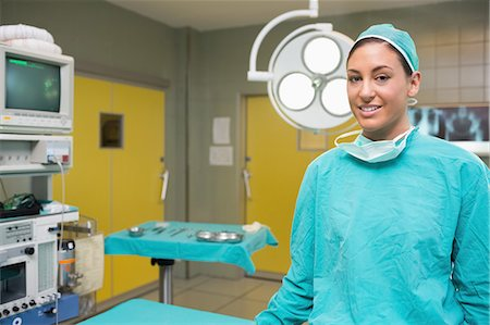 Smiling nurse next to a monitor Stock Photo - Premium Royalty-Free, Code: 6109-06195777