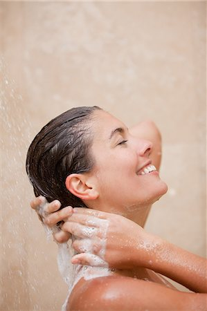 shower - Side view of smiling woman washing her hair in the shower Stock Photo - Premium Royalty-Free, Code: 6109-06195739