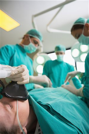 Focus on a patient lying on an operating table Stock Photo - Premium Royalty-Free, Code: 6109-06195894