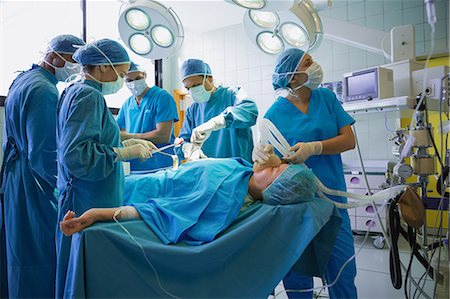 Team of hospital surgeons operating a patient Stock Photo - Premium Royalty-Free, Code: 6109-06195968