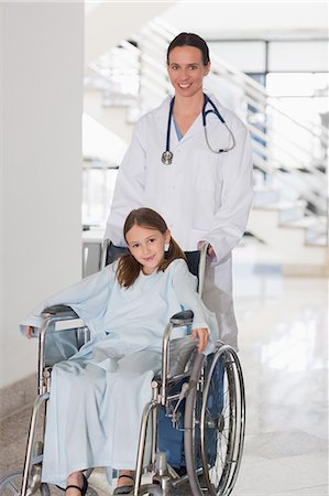 Doctor with a girl in a wheelchair Stock Photo - Premium Royalty-Free, Code: 6109-06195983