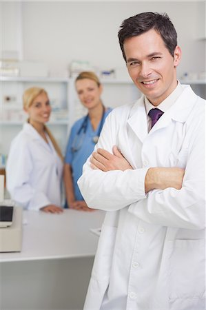 Pharmacist in a pharmacy with colleagues Stock Photo - Premium Royalty-Free, Code: 6109-06196101