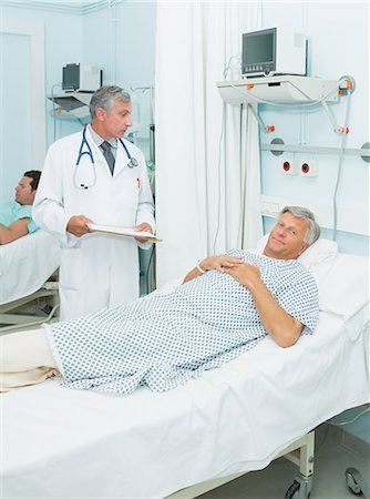 results - Doctor talking to a patient in a bed ward Stock Photo - Premium Royalty-Free, Code: 6109-06196253