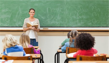 Female elementary teacher during class Stock Photo - Premium Royalty-Free, Code: 6109-06196443