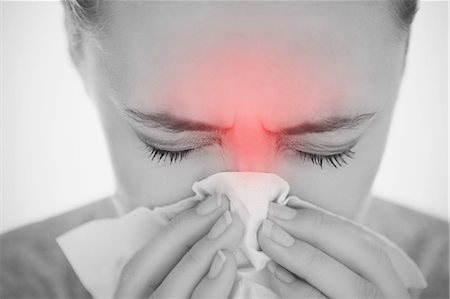 people coughing or sneezing - Woman blowing her nose with highlighted sinus pain Stock Photo - Premium Royalty-Free, Code: 6109-06684715