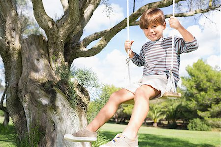 swing (sports) - Cute boy on swing hanging from tree Stock Photo - Premium Royalty-Free, Code: 6109-06684808