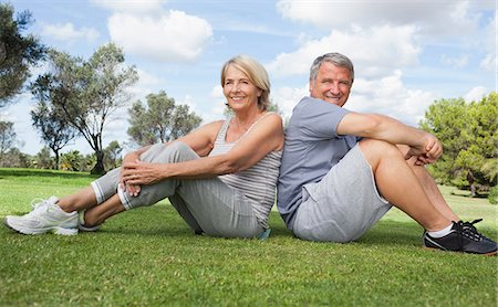 Portrait of older couple in sportswear back to back Stock Photo - Premium Royalty-Free, Code: 6109-06684948