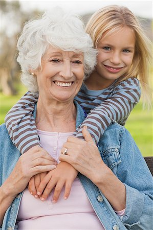 Elderly woman posing with her cute granddaughter Stock Photo - Premium Royalty-Free, Code: 6109-06684989