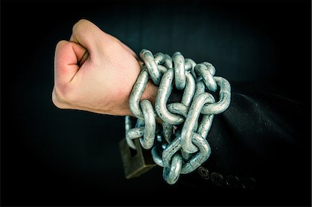 restrained - Hand wrapped in chain and lock Stock Photo - Premium Royalty-Free, Code: 6109-06684992