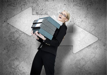 Woman struggling with work load Stock Photo - Premium Royalty-Free, Code: 6109-06684994