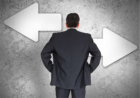 right - Businessman choosing which direction to go Stock Photo - Premium Royalty-Free, Code: 6109-06685003
