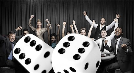 Attractive group cheering at the casino with digital dice Stock Photo - Premium Royalty-Free, Code: 6109-06685007