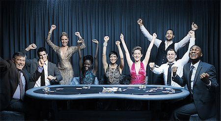 Attractive group cheering at the casino Stock Photo - Premium Royalty-Free, Code: 6109-06685005