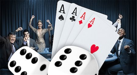 Attractive group cheering at the casino with digital cards and dice Stock Photo - Premium Royalty-Free, Code: 6109-06685006