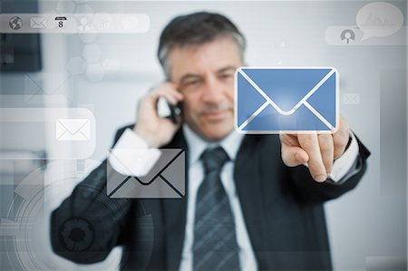 Businessman selecting email application on touchscreen Stock Photo - Premium Royalty-Free, Code: 6109-06685025