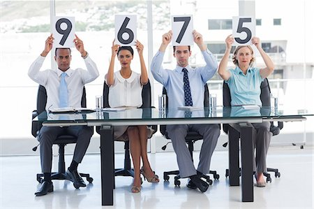 scoring - Sitting panel of judges raising notices with marks Stock Photo - Premium Royalty-Free, Code: 6109-06781343