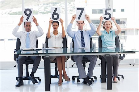 scoring - Sitting panel of judges showing marks Stock Photo - Premium Royalty-Free, Code: 6109-06781342