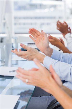 Close up of clapping hands Stock Photo - Premium Royalty-Free, Code: 6109-06781355