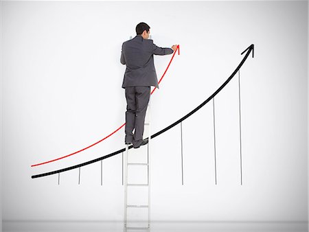 Businessman standing on ladder drawing graph Stock Photo - Premium Royalty-Free, Code: 6109-06781459