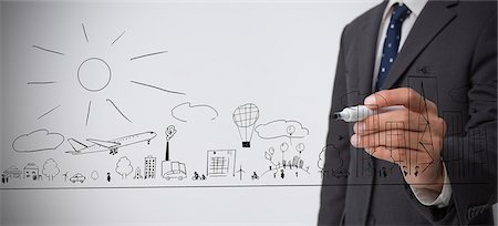 string - Businessman drawing a town Stock Photo - Premium Royalty-Free, Code: 6109-06781464