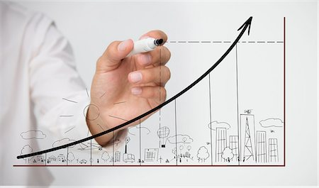 Businessman drawing graph over town doodle Stock Photo - Premium Royalty-Free, Code: 6109-06781468