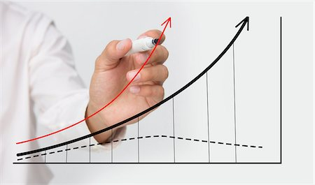 Businessman drawing graph Stock Photo - Premium Royalty-Free, Code: 6109-06781469