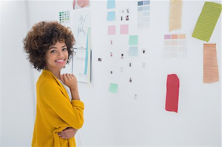 Cute designer standing in front of material samples Stock Photo - Premium Royalty-Free, Code: 6109-06781471