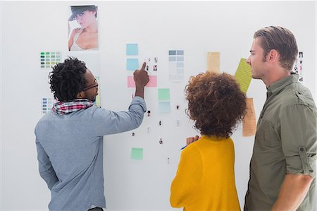 self adhesive note - Team of designers pointing at a group of photos Stock Photo - Premium Royalty-Free, Code: 6109-06781484